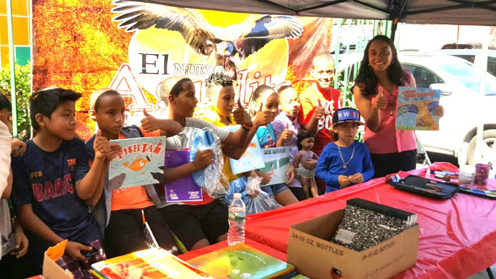 Assemblywoman Latoya Joyner joins children on Ogden Avenue for a Back-to-School event for the community.