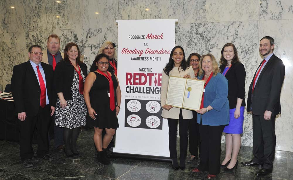 Assemblywoman Latoya Joyner presents her resolution to members of the Bleeding Disorders Association of Northeastern New York, which declares March as Bleeding Disorders Awareness Month in New York St