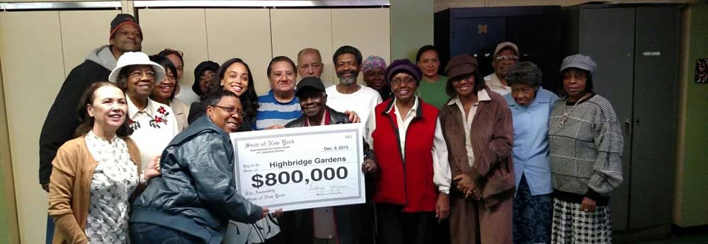 Assemblywoman Latoya Joyner presents a ceremonial check to the NYCHA Highbridge Gardens for planned work to improve security and lighting for families.<br />