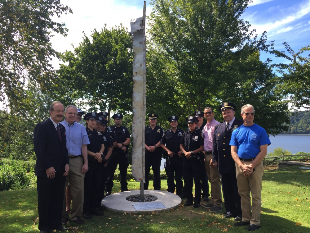 Assemblyman Dinowitz participated in a dedication ceremony where an artifact from the World Trade Center became a permanent memorial. Pictured are Assemblyman Dinowitz,  Councilmember Andrew Cohen, Congressman Eliot Engel along with representatives from the 50th Precinct, including Deputy Inspector Terrence O'Toole and CEO of RiverSpring Health, Daniel Reingold.<br />