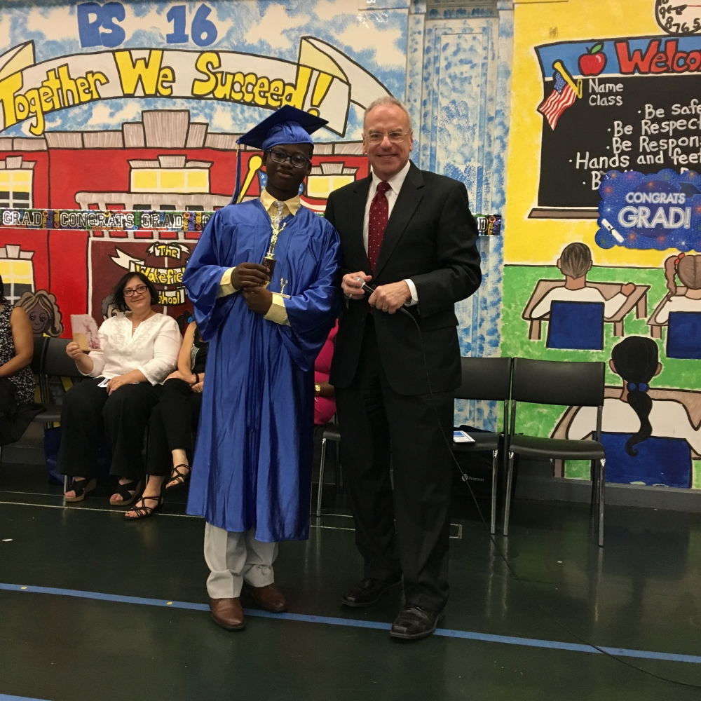 Assemblyman Dinowitz attending the June 22nd Graduation Ceremony of PS 16 pictured presenting the Community Service Award to Jair Joseph.