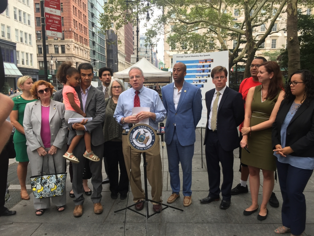 Assemblyman Jeffrey Dinowitz, Chair of the Assembly Committee on Corporations, Authorities, and Commissions, pictured here with fellow city and state elected officials as well as transit advocates at