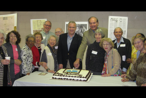 Residents of the Fieldstondale Mutual Housing Cooperative recently celebrated their 50th anniversary. Assemblyman Jeffrey Dinowitz and Councilman Oliver Koppell, surrounded by many of the co-op's original residents, cut a cake in celebration.