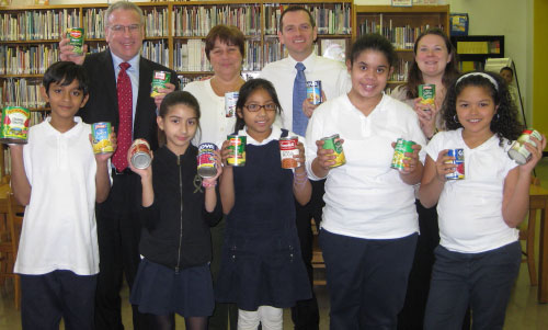 Assemblyman Jeffrey Dinowitz visited P.S. 7 in Kingsbridge where he is pictured with Principal Frank Patterson, Tara McMaster, Kelly Links, and student government leaders who are holding cans of food at the school library. The school collected hundreds of pounds of food for Assemblyman Dinowitz's canned food drive. The food was donated to the Kingsbridge Heights Community Center and the food pantry at Saint Francis of Rome Church in Wakefield for families in need.