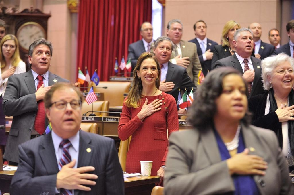 Saying the pledge of allegiance on the Assembly floor.
