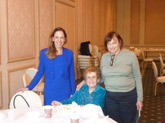 Assemblywoman Amy Paulin gave out holiday cookies to the seniors at Temple Beth-El in New Rochelle. That's 100-year-old Tilly Auerrabach seated next to her.
