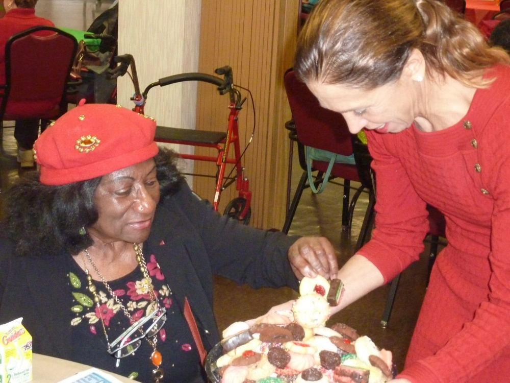 Amy Paulin hands out cookies to seniors at the Doyle Center in New Rochelle.