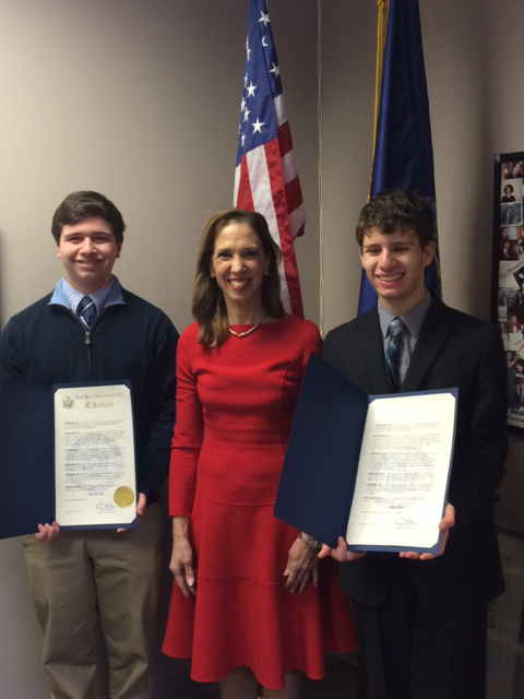 Pelham's Max Pine (l) and Scarsdale's David Frank joined Amy Paulin on Jan. 28 at her District office to receive certificates of achievement for their scientific work for the Intel Science Talent Search. Frank is a national semi-finalist while Pine is one of 40 finalists.