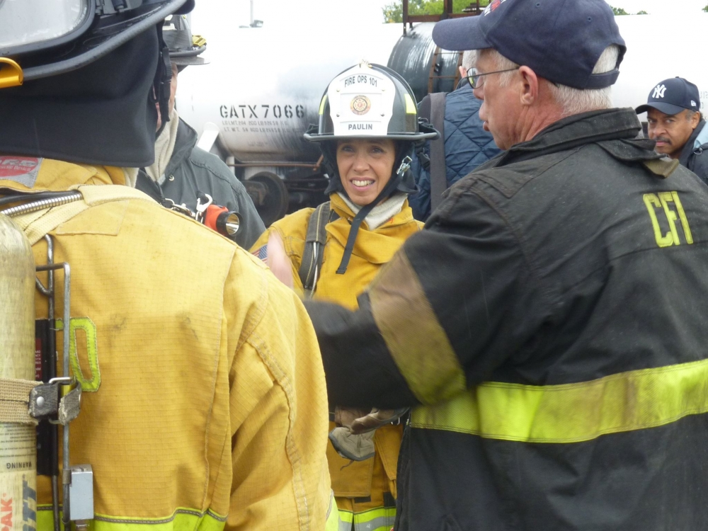 Assemblywoman Amy Paulin prepares to use the Jaws of  Life on a vehicle as part of the Fire Ops 101 demonstration.
