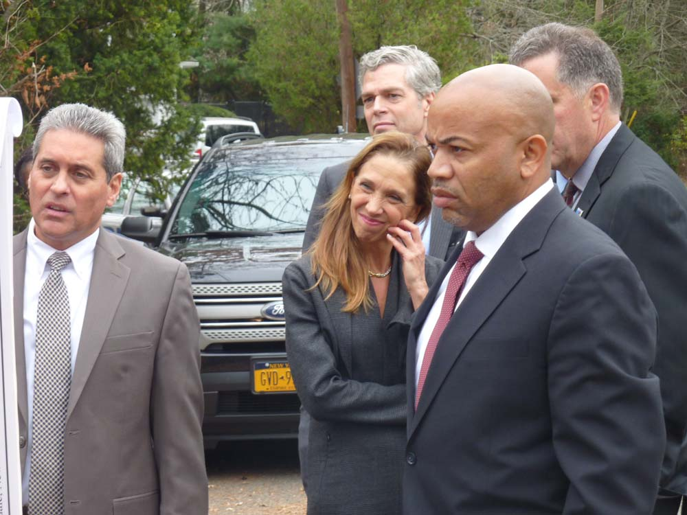 Assemblywoman Amy Paulin and Assembly Speaker Carl Heastie toured a bridge over the Hutchinson River on the Scarsdale/New Rochelle border to discuss flood mitigation.