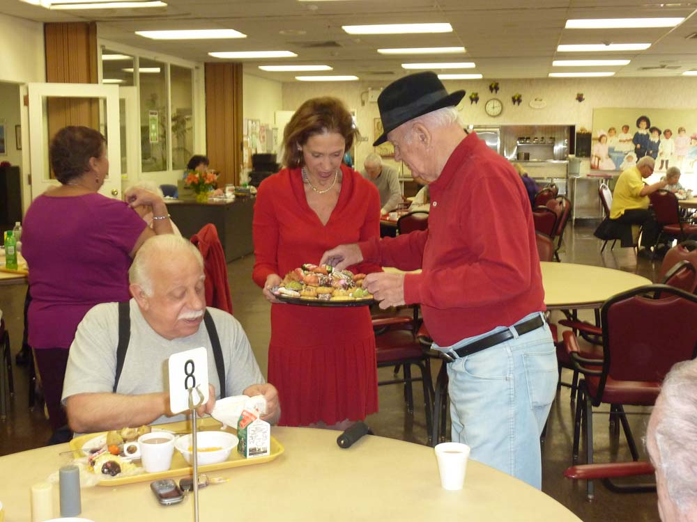 Assemblywoman Amy Paulin handed out holiday cookies recently at the Doyle Senior Center in New Rochelle.