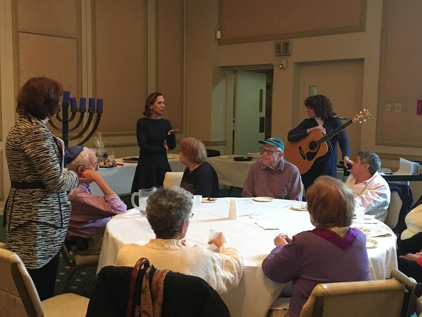 Assemblywoman Amy Paulin visited Bethel Synagogue in New Rochelle, where she handed out holiday cookies, sang carols and lit the Menorah.