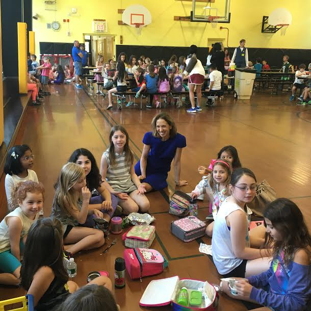 Assemblywoman Amy Paulin went to the Heathcote School in Scarsdale for a visit with the students. She met with Lucy Forest and Rania Palaniappan and they gave her a tour of the building. She also visited with the students in the cafeteria as they ate their lunch.