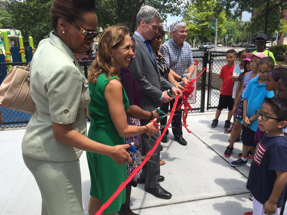 Assemblywoman Amy Paulin takes part in the ribbon-cutting ceremony for the new playground in the city's Kittrell Park. Paulin helped secure some of the funding to rebuild the playground.<br />