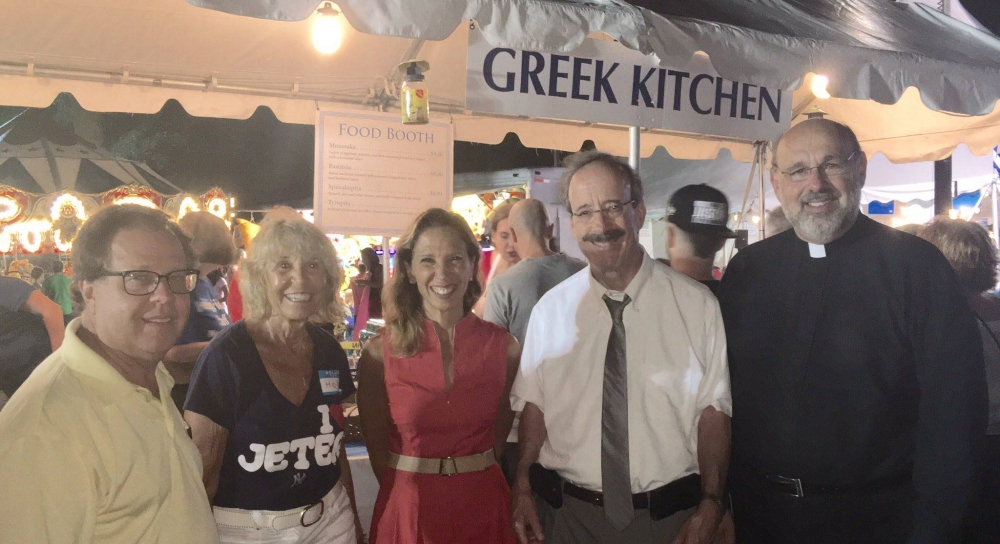 Assemblywoman Amy Paulin attended the Greek Festival at The Holy Trinity Greek Orthodox Church in New Rochelle. Here she is with fellow Assembly member Tom Abinanti, Congressman Eliot and Father Nick.<br />