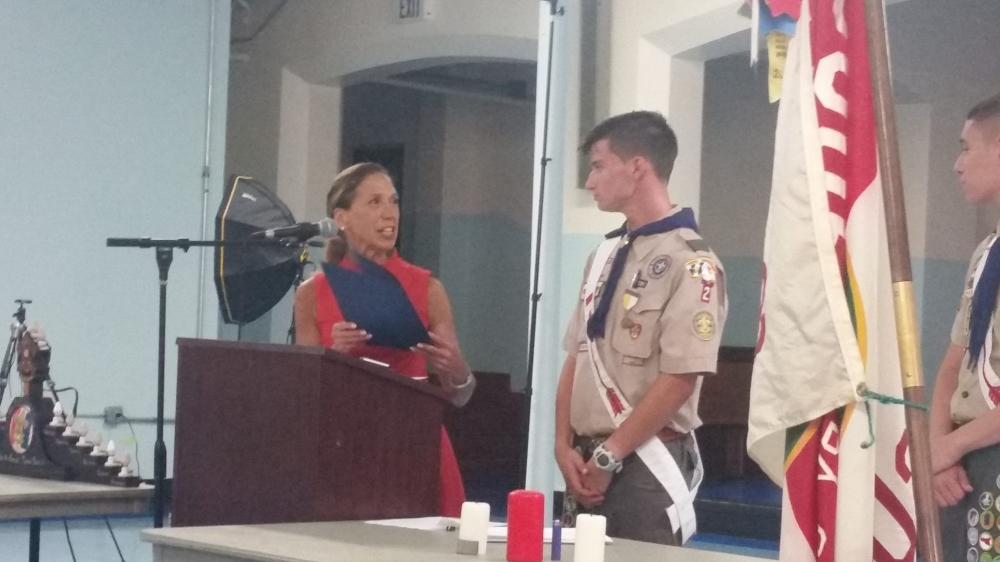 Assemblywoman Amy Paulin helped honor Matthew Taylor as he earned the rank of Eagle Scout.<br />