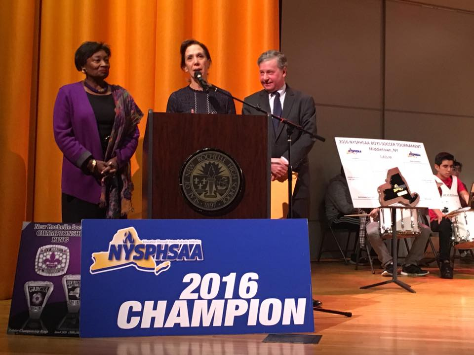 Assemblywoman Amy Paulin with Assemblyman Steve Otis and State Senator Andrea Stewart Cousins at the ceremony honoring New Rochelle High's state championship boys soccer team. <br />