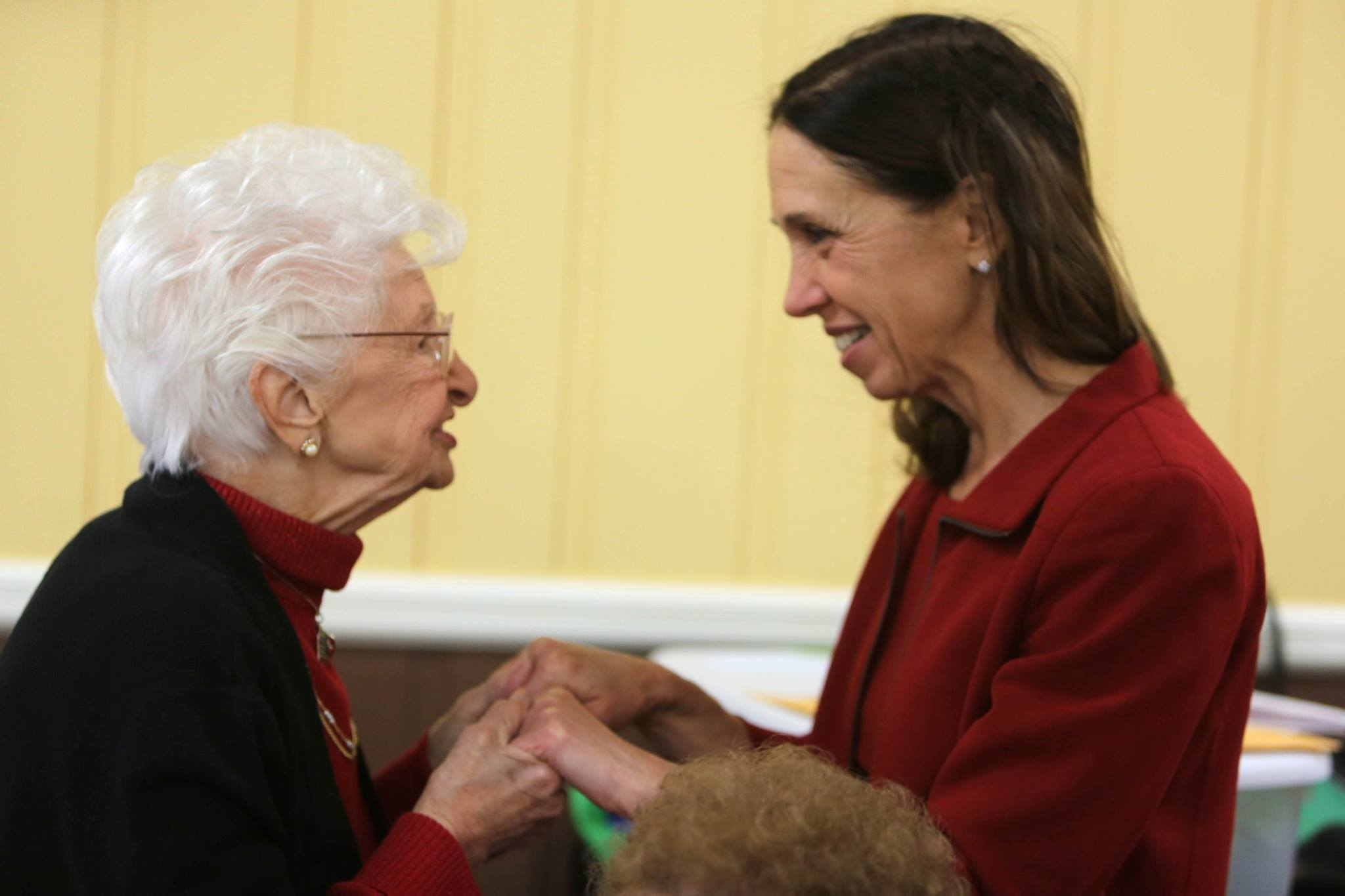 Assemblywoman Amy Paulin interacting with a Tuckahoe senior while giving out holiday cookies.