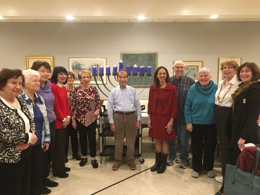 Assemblywoman Amy Paulin gave out holiday cookies and lit the menorah at Beth-El Synagogue Center in New Rochelle.