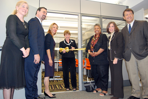 Assemblywoman Amy Paulin, Assemblyman George Latimer and Sen. Suzi Oppenheimer cut the ribbon on a new computer lab in New Rochelle's public library.