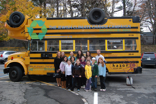 Assemblywoman Paulin and students from the Temple Israel Center in White Plains gather around the Jewish Climate Change campaign's veggie-fuel-powered bus.