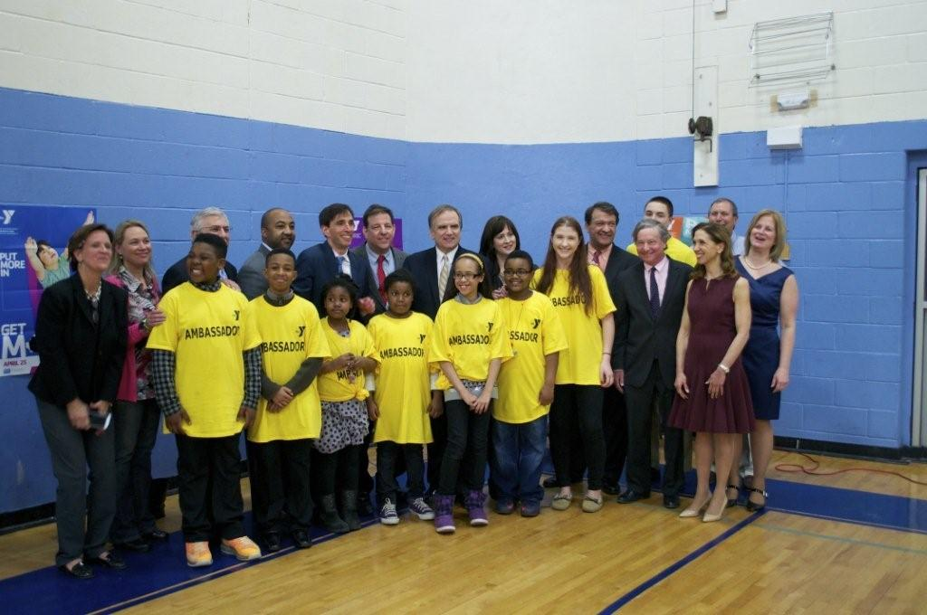 Assemblymember Otis meets with student ambassadors at an event in support of the New Rochelle YMCA.