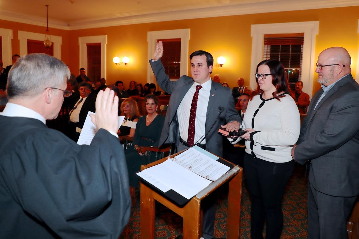 Assemblyman Byrne sworn in by Judge James Reitz, with wife Briana standing next to him