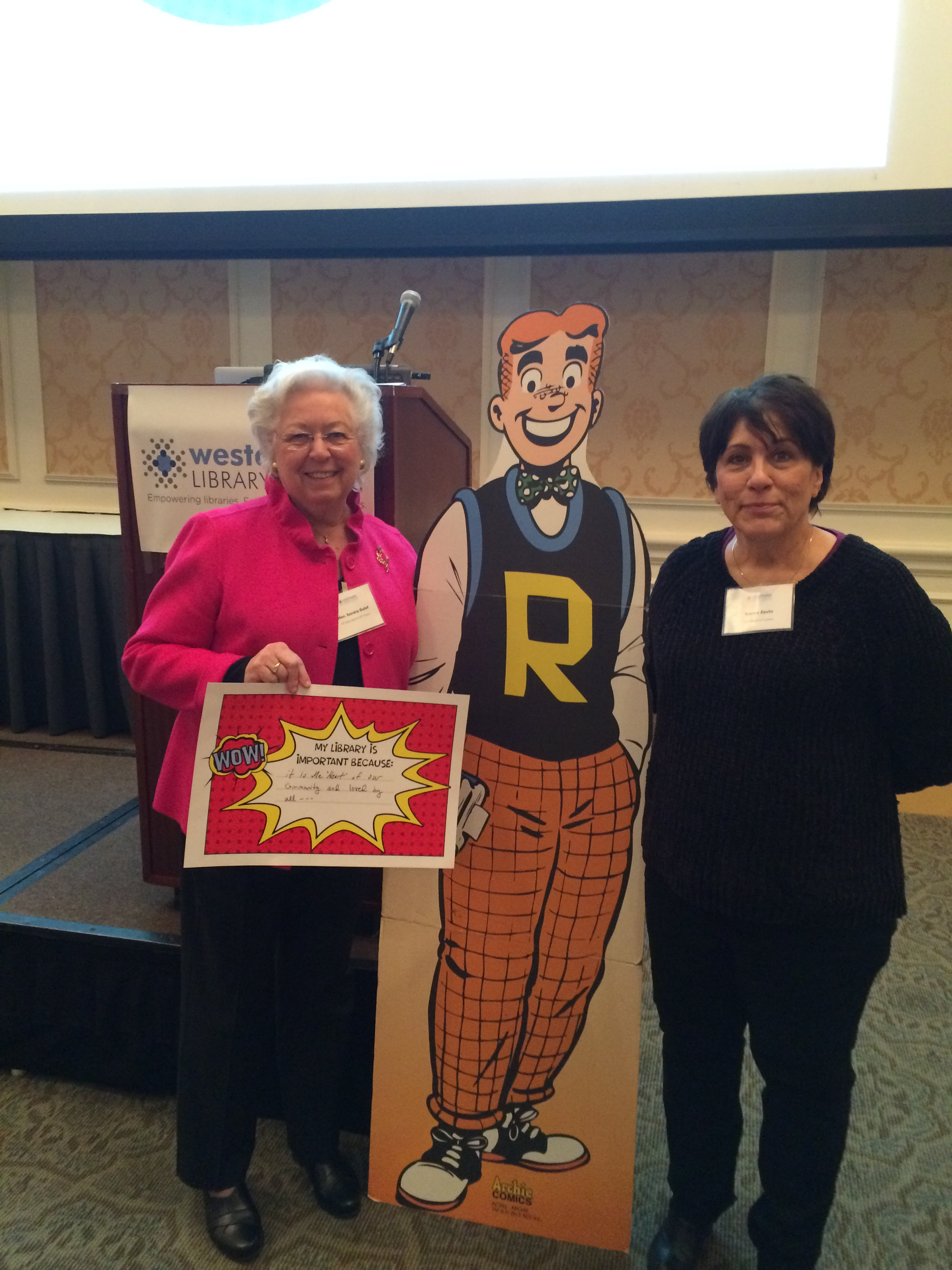 Sandy attended a Westchester Library System event with Croton Resident and Westchester Library Trustee Karen Zevin and a cutout of Archie from the classic comic strip.
