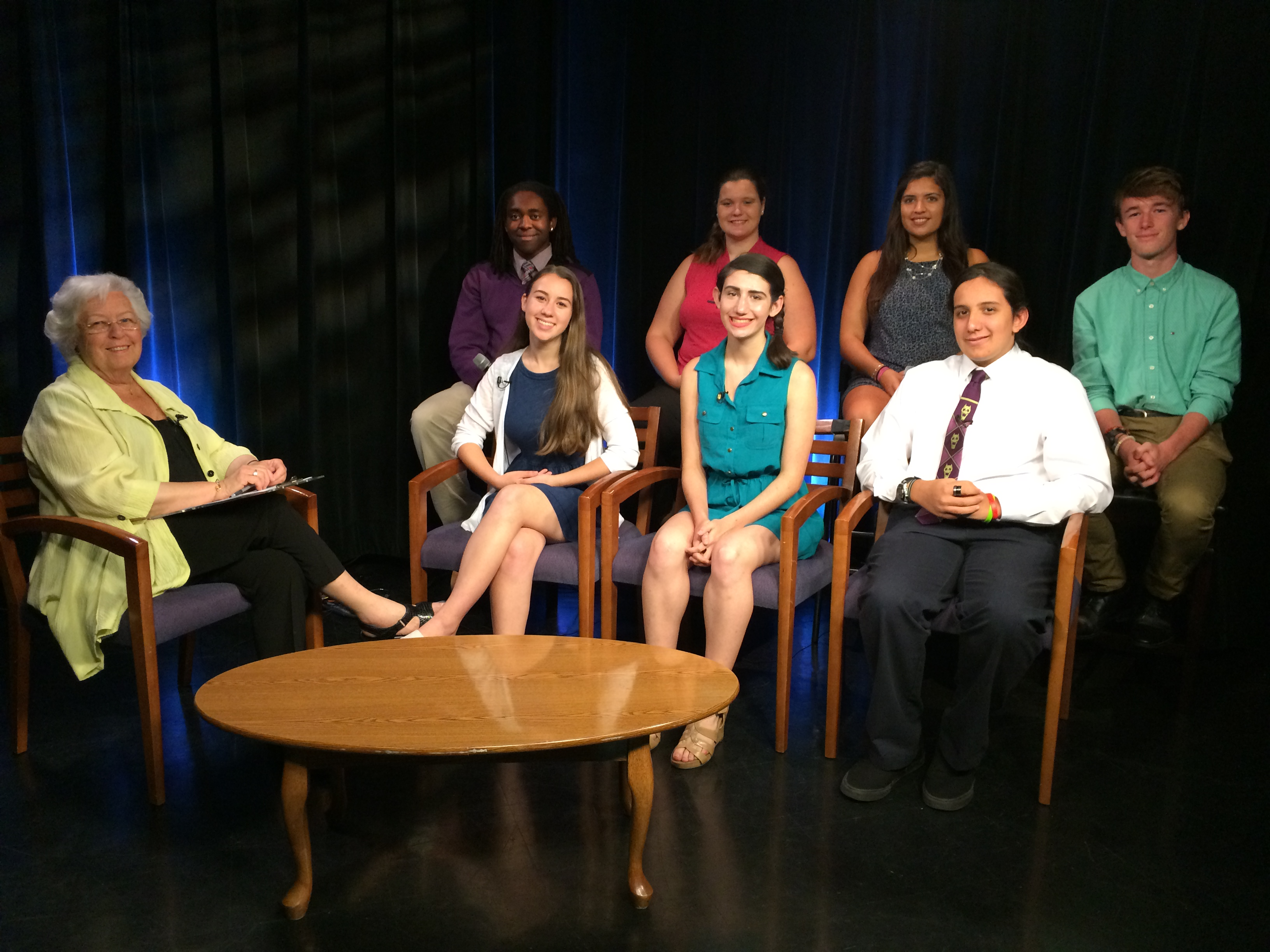 "Sandy sitting down with her interns on the set of her TV show, ""Dear Sandy"". She has two television programs, ""Dear Sandy"" and ""Speak Out,"" which air on public access cha"