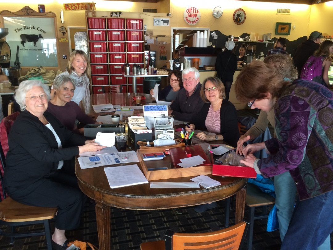 Sandy sitting down at the Black Cow with constituents who were writing postcards to their federal and state representatives.<br />&nbsp;