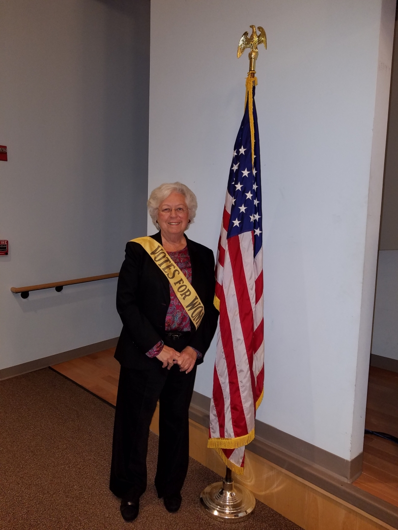 We are currently celebrating the 100th anniversary of women&rsquo;s suffrage in New York State. Sandy had the opportunity to try on an authentic sash worn by a suffragist during the movement.<br />&nbsp;