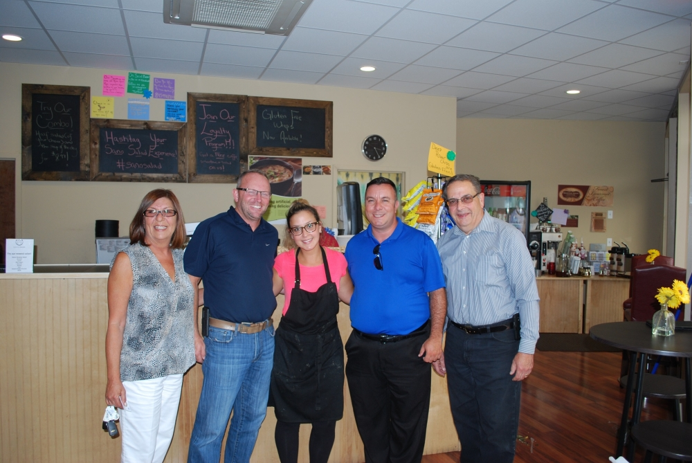 From left to right, Laurie Dziedzic, President of the Greater Monroe Chamber of Commerce (GMCOC); James Purcell, Mayor of the Village of Monroe; Raquel Zippilli, Owner of Sano Salads, a new business in Monroe; Assemblyman Brabenec; and Paul Campanella, former President of the GMCOC.