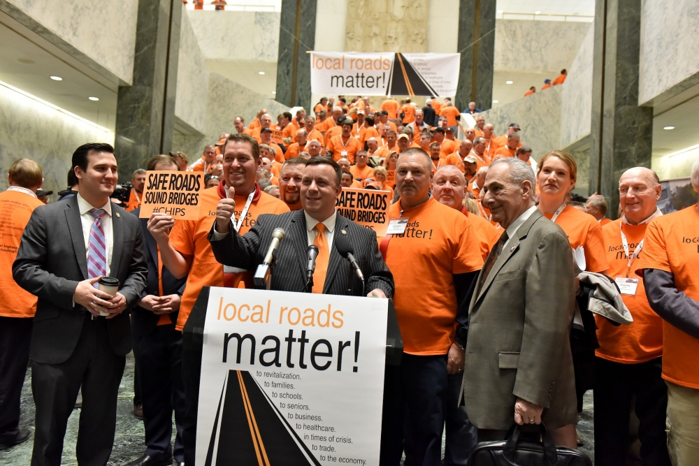 Assemblyman Karl Brabenec (R,TCN-Deerpark) [at podium] today joined legislators and construction workers at an Albany rally to call for increased funding for local roads and highways.<br />&nbsp;