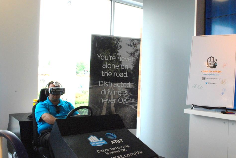 Assemblyman Karl Brabenec (R,TCN-Deerpark) drives the AT&T simulator that gives participants a realistic perspective of the dangers of using electronic devices while driving<br />&nbsp;