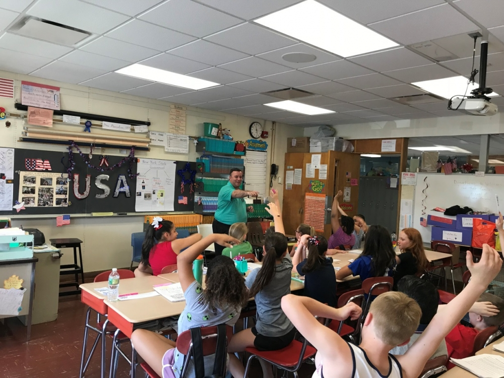 Assemblyman Karl Brabenec [front] listens to public policy ideas from students at Minisink Valley Intermediate School Friday