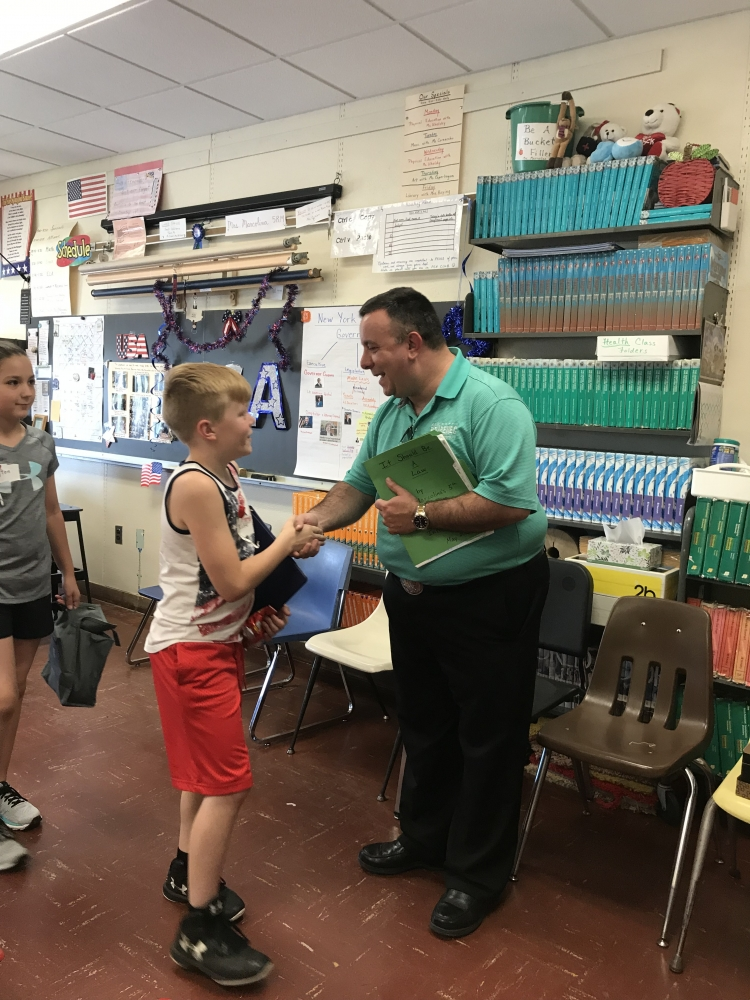 Assemblyman Karl Brabenec [front] listens to public policy ideas from students at Minisink Valley Intermediate School Friday<br />&nbsp;