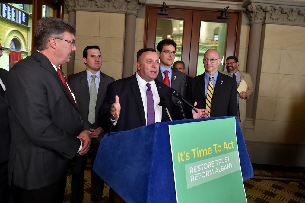Assemblyman Karl Brabenec [at podium] joins colleagues in Albany to fight corruption in New York's economic development programs
