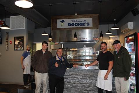 Brabenec [center left] poses with owners of Rookie's on Main Street in Florida.