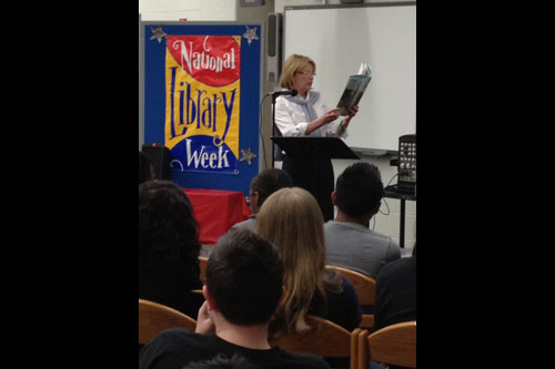 Aileen reads to students at the Great Otisville Read Aloud at Minisink Valley Middle School.