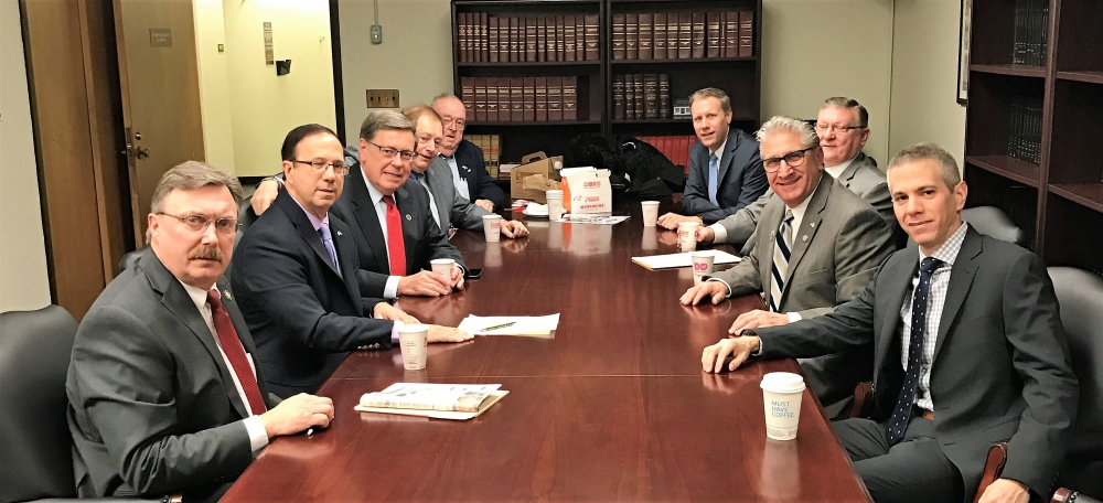 The Mohawk Valley Nine hold their initial caucus meeting at the Capitol in Albany.  Left side of table from front, Assemblyman Miller, Senator Griffo, Senator Seward, Assemblyman Butler, Assemblyman M