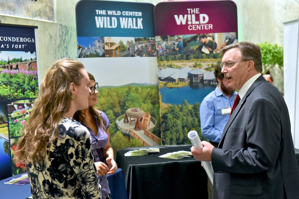Assemblyman Brian Miller speaks with representatives from different groups in the Adirondack region of New York State to promote regional tourism at Adirondack Day in Albany.