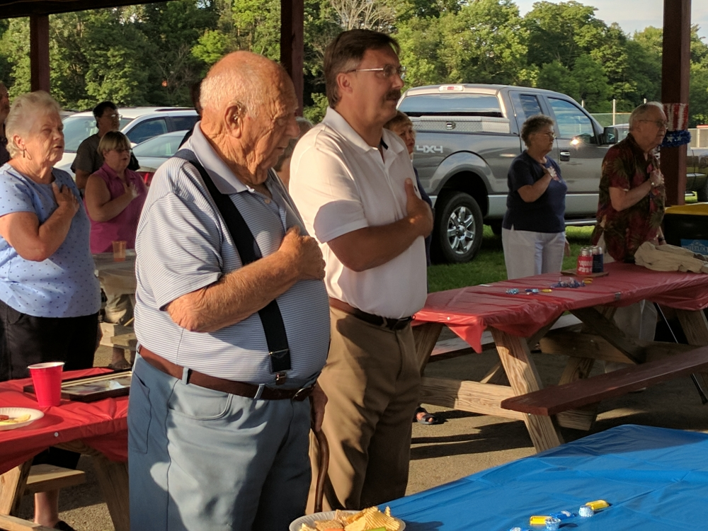 Assemblyman Miller recites the Pledge of Allegiance with local veterans and<br /> their families at the annual West Winfield VFW picnic.<br />