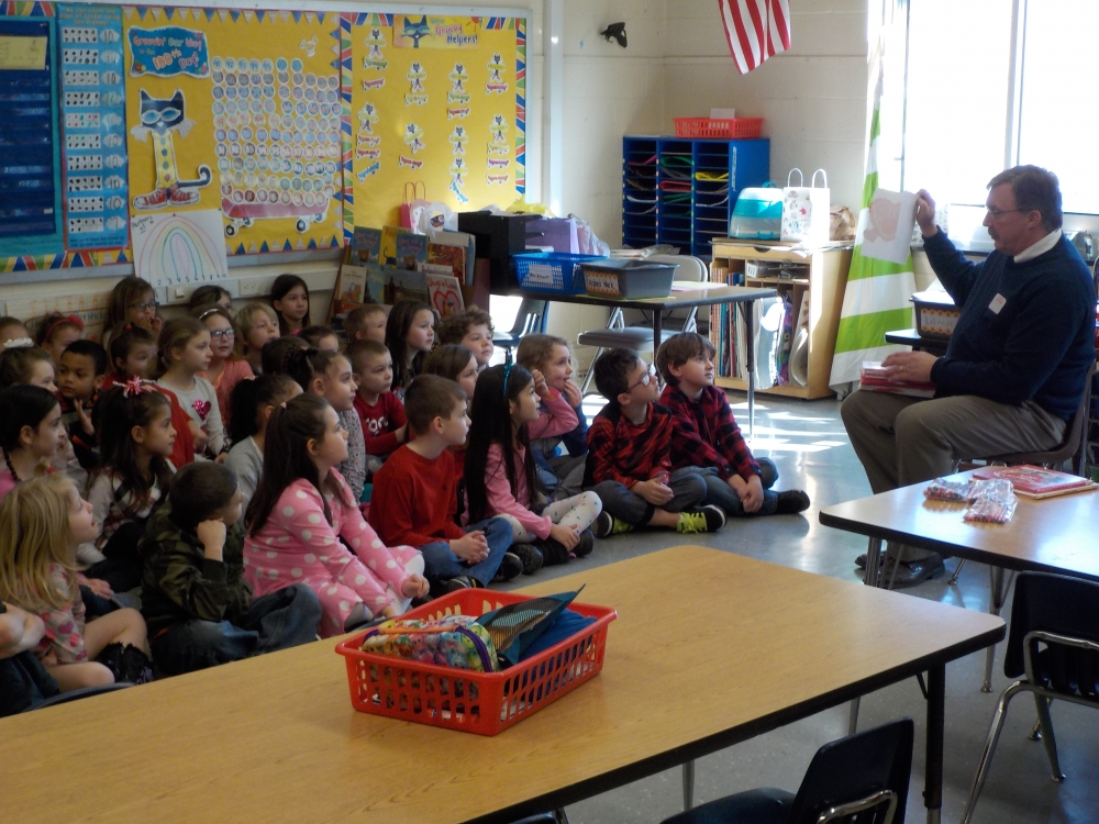 (Left): The first graders at Ostrander Elementary created Valentines for seniors with Assemblyman Brian Miller.
