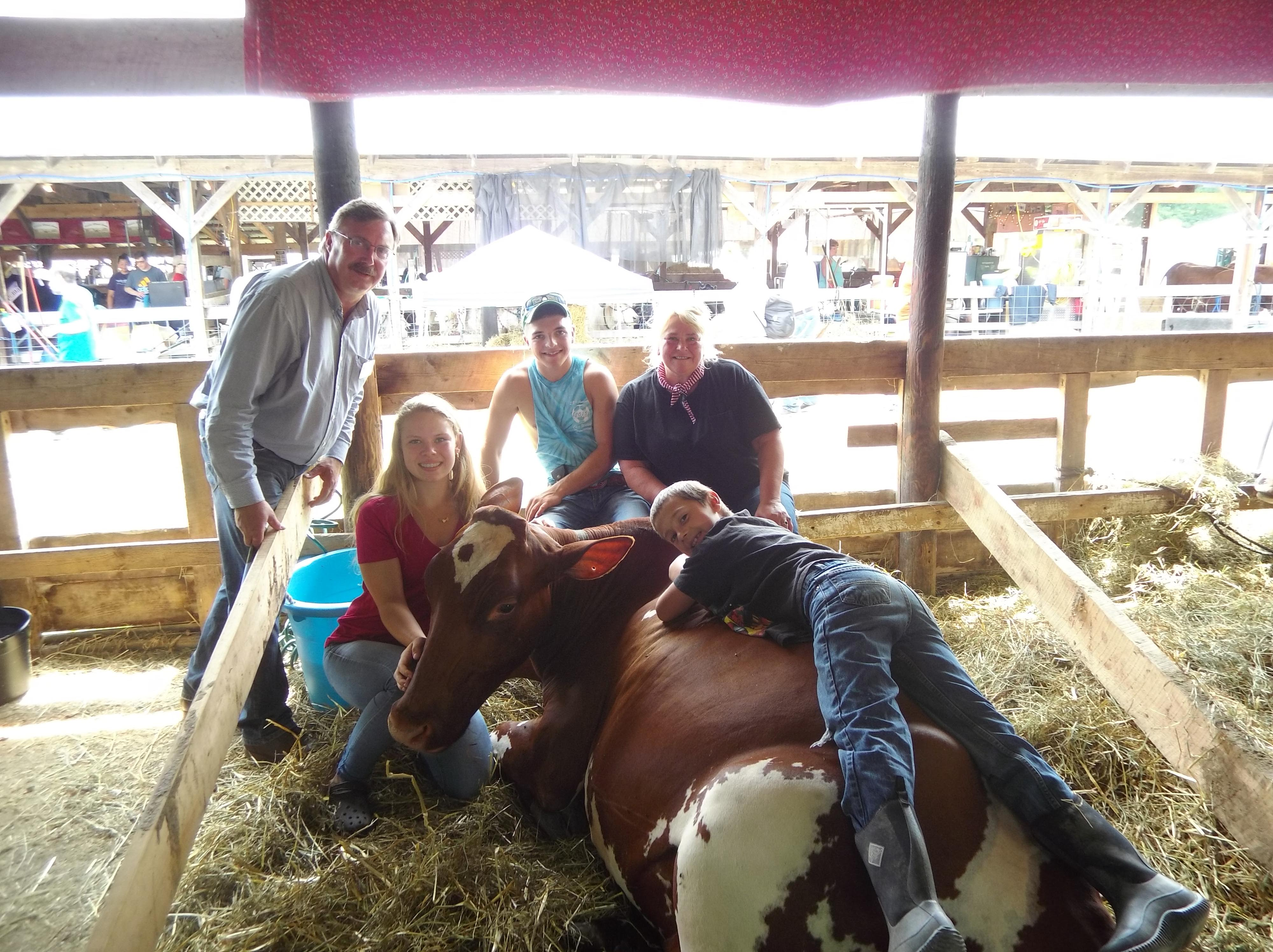 (Left to right): Assemblyman Brian Miller, Alexi Baran, Payton Stirone, Shelly Schaffer (Front – on cow): Jonathan Latour
