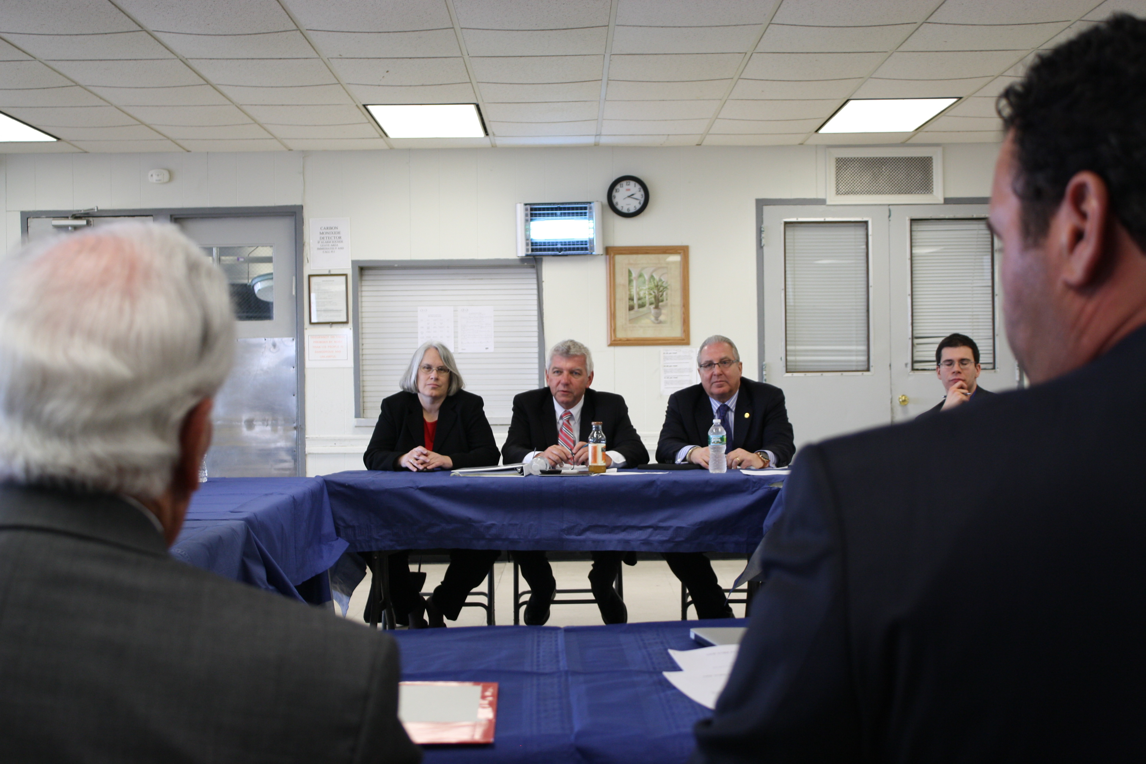 Assembly Insurance Committee Chair Kevin Cahill conducts a roundtable discussion on insurance issues in the wake of Superstorm Sandy alongside Assemblymember Steven Cymbrowitz (right) and Assemblymember Helene Weinstein (left).