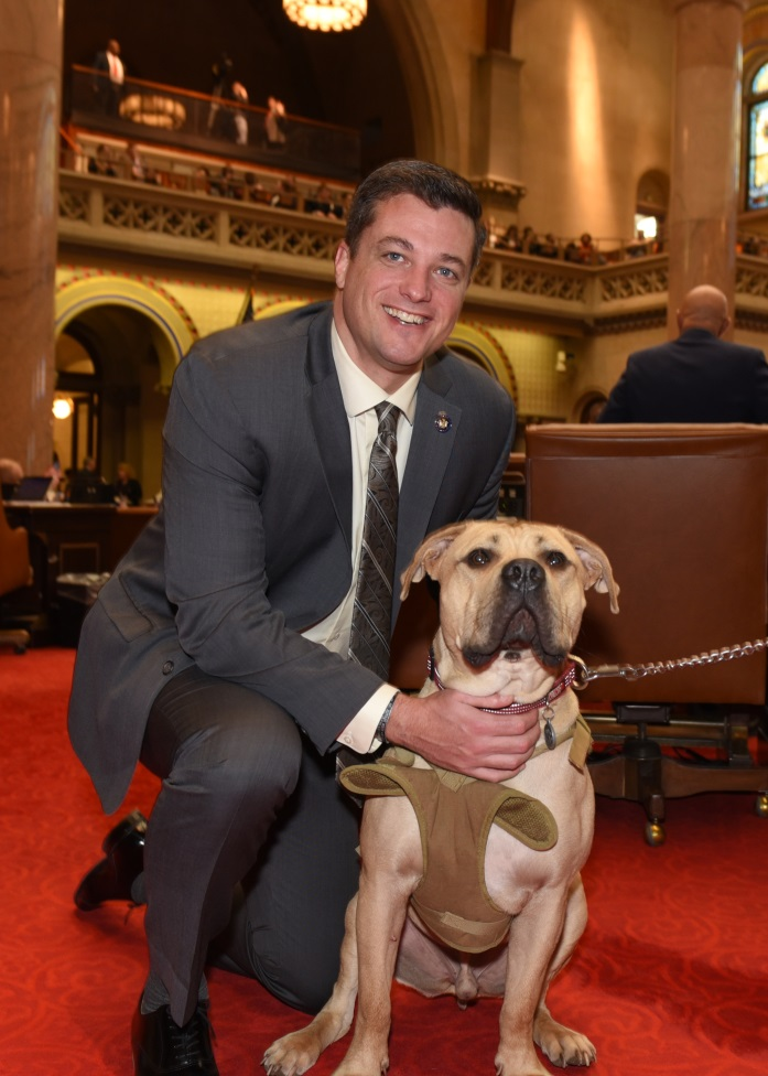 Assemblyman Jake Ashby (R,C,I,Ref-Castleton) is pictured with Leroy, a one-year-old boerboel mastiff who is being trained to be a service animal to veterans of the military or first responders.