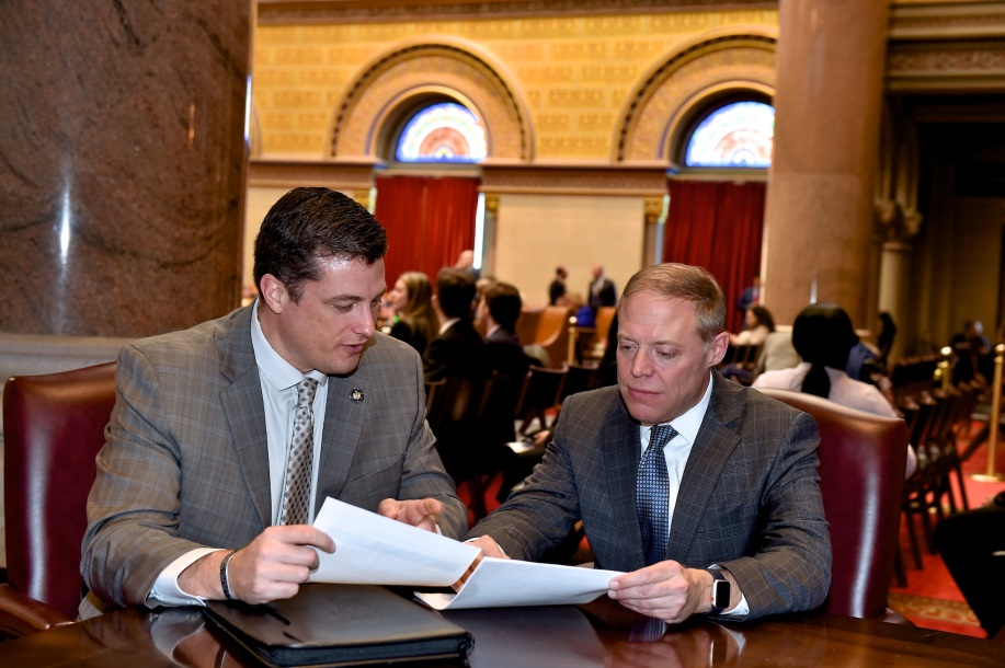 Assemblyman Jake Ashby (R,C,I,Ref-Castleton) and Assembly Minority Leader Will Barclay (R,C,I,Ref-Pulaski) discuss legislation in the Assembly Chamber in the Capitol.