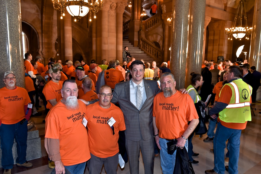(Left to right) Kenny Holmes, Dave Anthony, Assemblyman Jake Ashby (R,C,I,Ref-Castleton) and  Joe Teliska after a rally held in the State Capitol calling for increased funds for local roads.