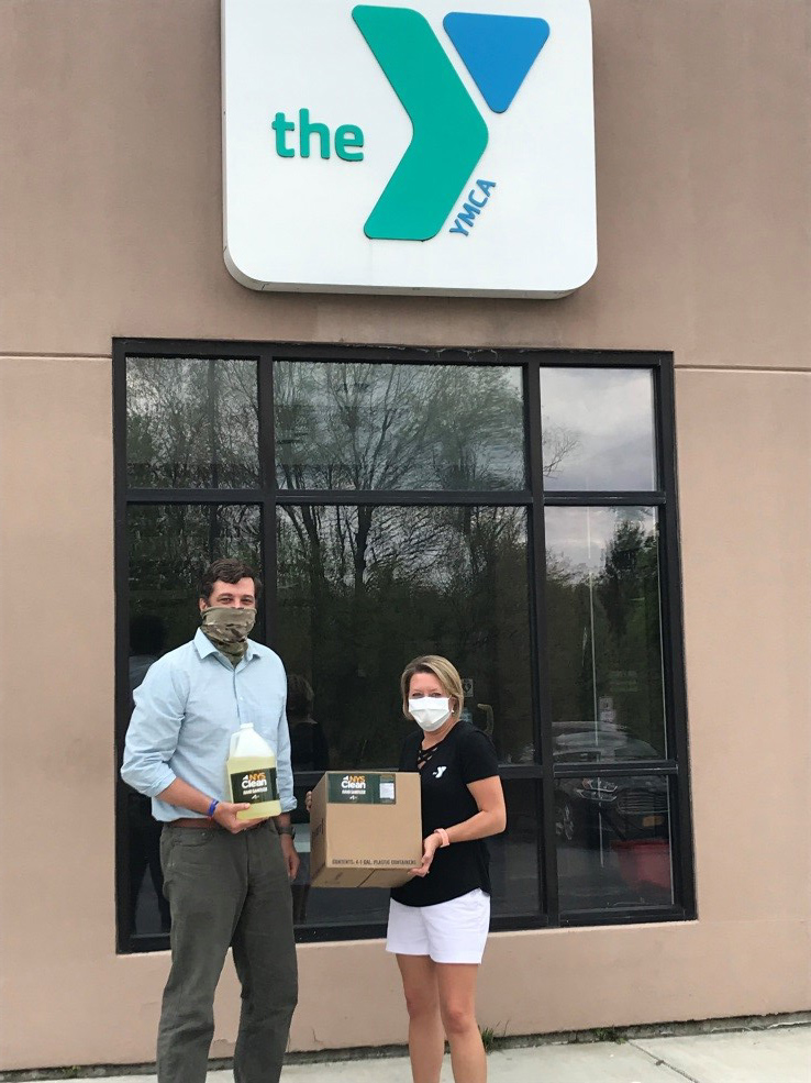 Assemblyman Jake Ashby (R,C,I,Ref-Castleton) delivers hand sanitizer to Shannon Romanowski, executive director of the Greenbush Area YMCA.