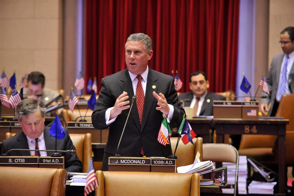Assemblymember McDonald debating on the floor of the Assembly Chamber during legislative session.